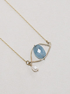 Claire van Holthe faceted aquamarine bead eye necklace with freshwater pearl teardrop set in 9 carat gold eye wire frame