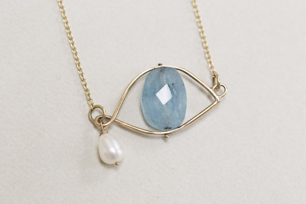natural blue aquamarine with a soft white freshwater pearl - a signature look of Claire van Holthe's jewellery