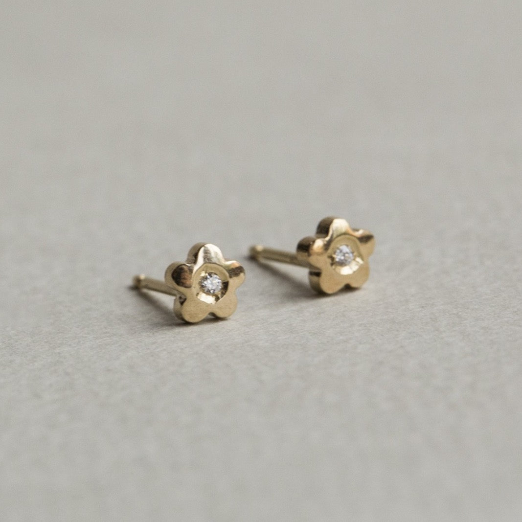 side view of our lovely gold flower studs - they come with matching butterflies