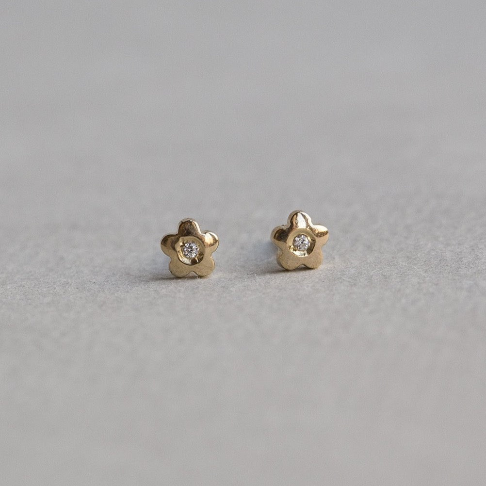 felt 9 carat gold micro flower stud earrings with cubic zirconia