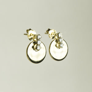 side view of Davina Combes Disc with Stones Drop Earrings
