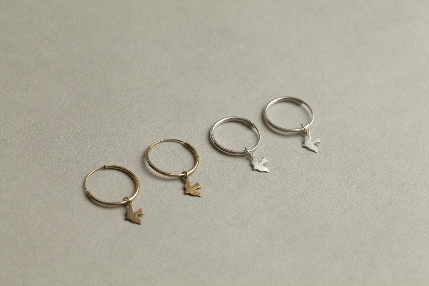 Alice Eden gold plated silver dickie bird hoop earrings, available at feltlondon.com