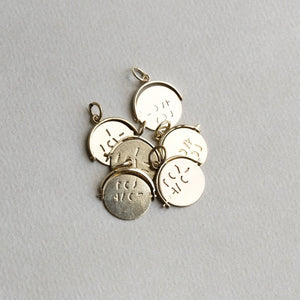 these vintage pendants although very similar, will vary slightly in form or lettering