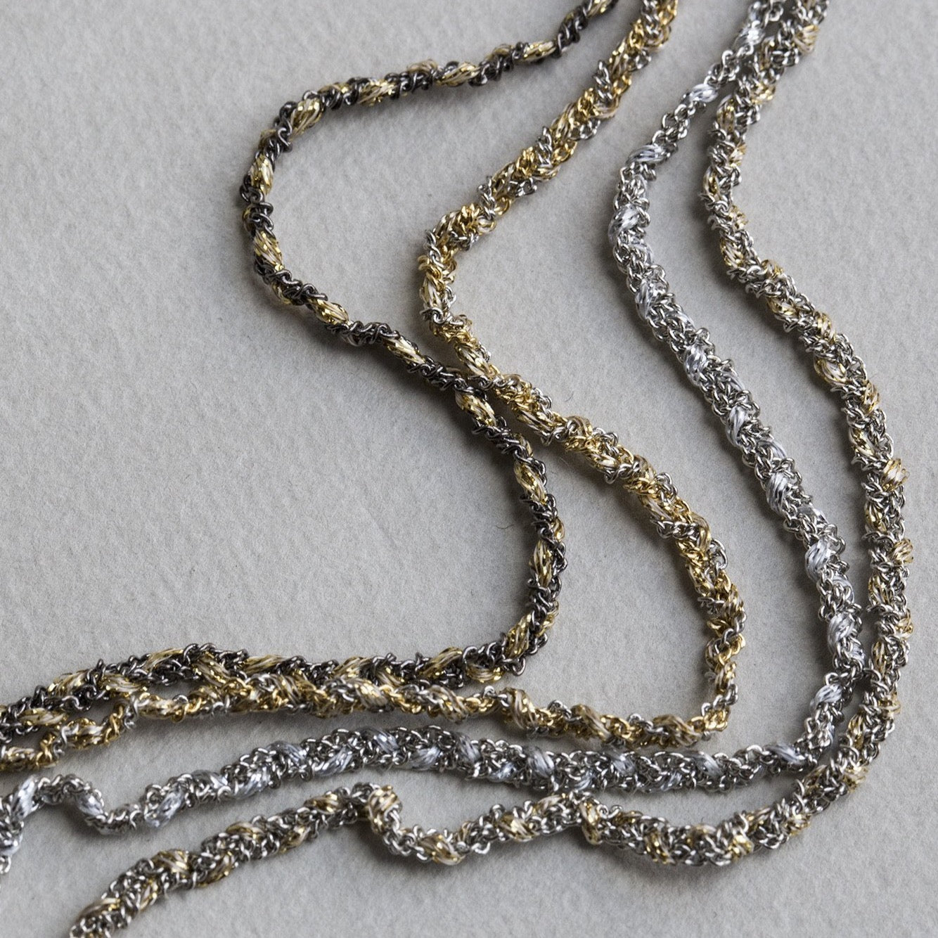 from left: black chain/gold thread, gold chain/silver thread, silver chain/silver thread and silver chain/gold thread