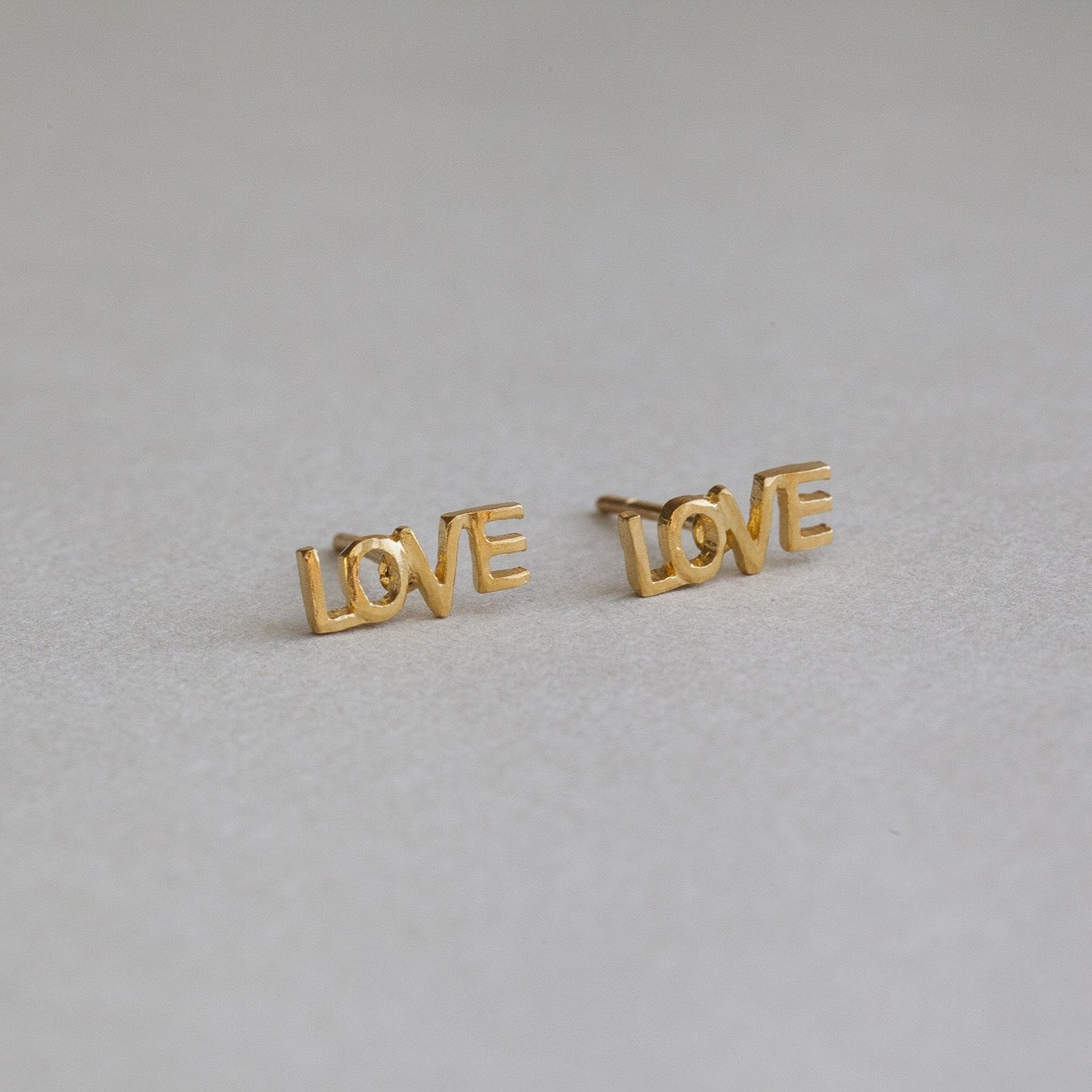 felt gold plated silver LOVE stud earrings