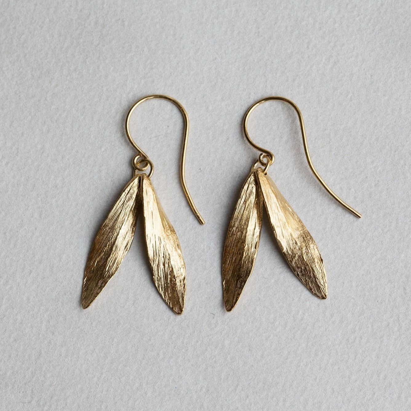 Catherine Zoraida double leaf gold plated hook earrings