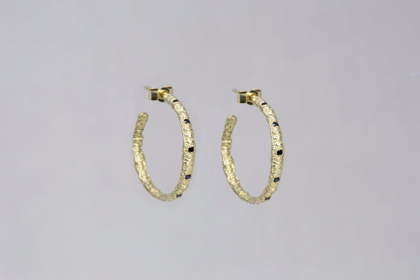 "Also by the same designer ""Straight Stitch Hoops with Black Diamonds"""