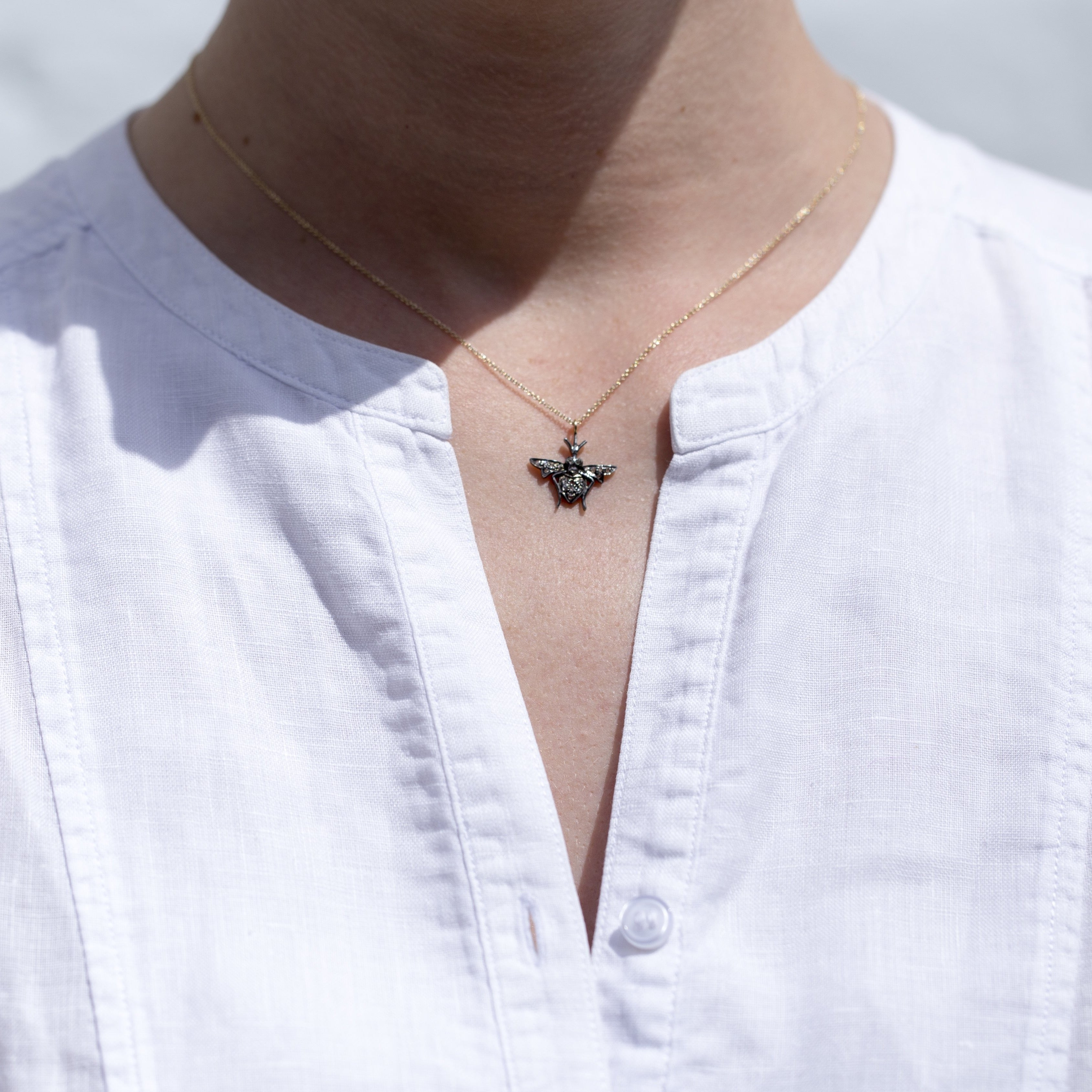 Bumble Bee Pendant with a gold chain as a necklace