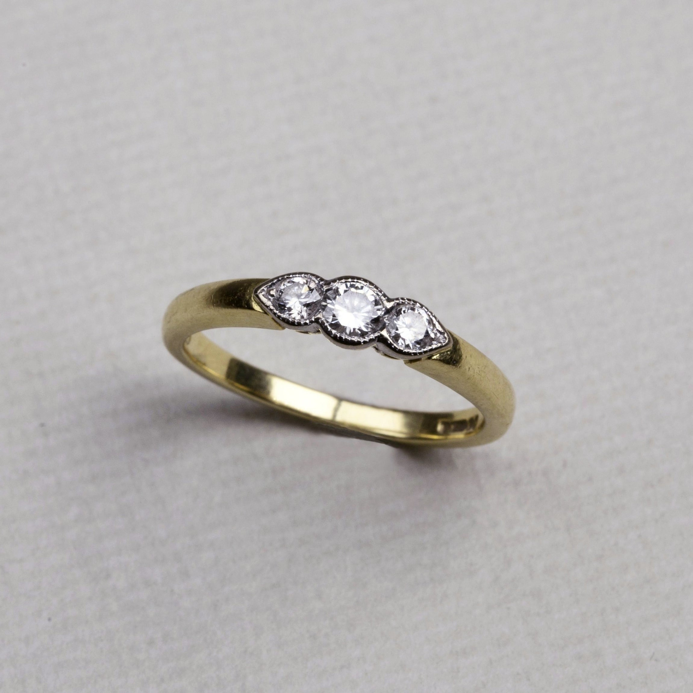 18ct gold with 3 diamonds