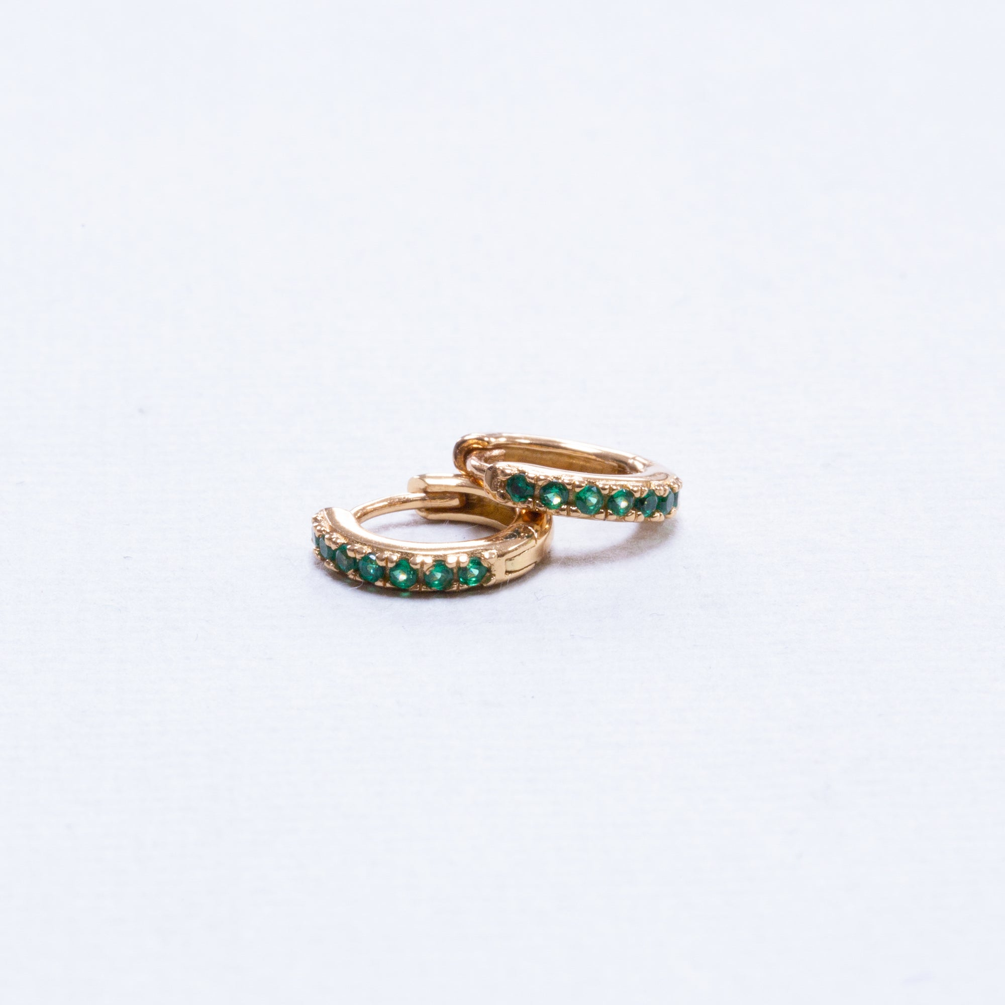 Huggie Hoop Earrings with Green Cubic Zirconia