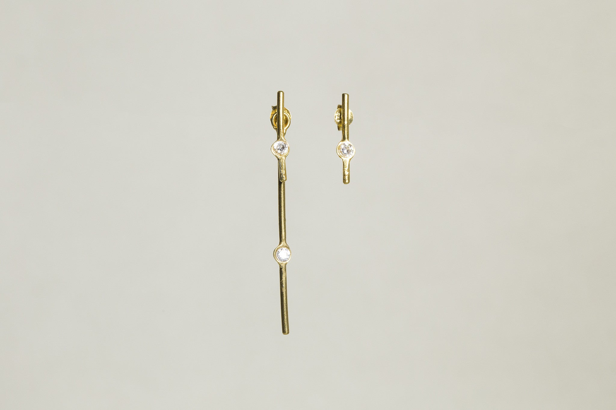 similar to starburst earrings but for minimalists - the long stick jacket can be taken off! also available on feltlondon.com