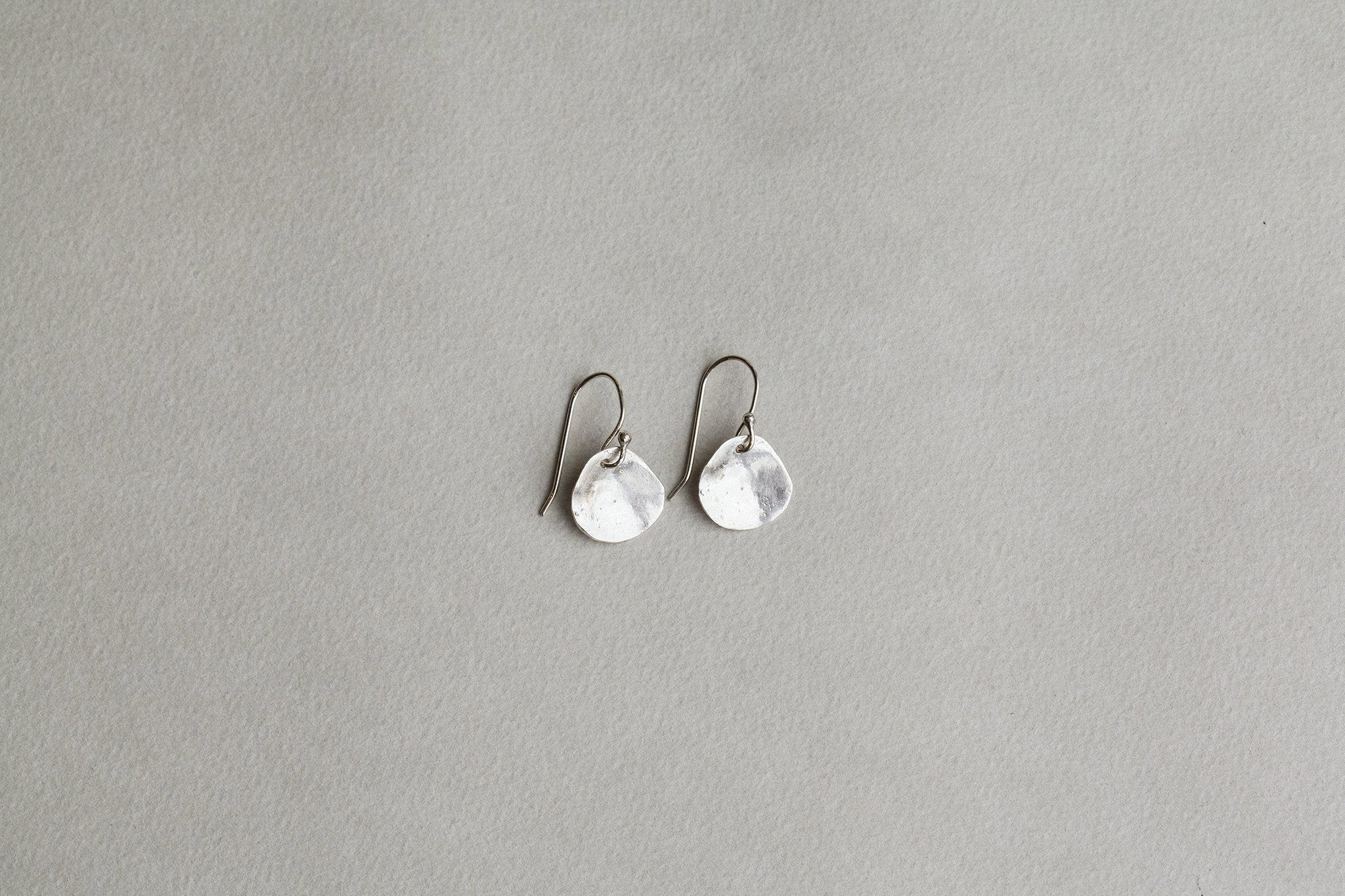 hammered silver disc hook earrings are our bestselling silver earrings also by Karen Hallam