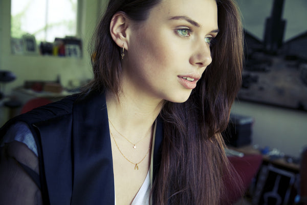 our model wearing gold plated Alice Eden hoops, Marian Maurer star necklace and felt gold wishbone necklace.