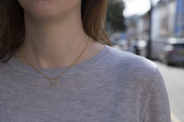 the delicate necklace on a model