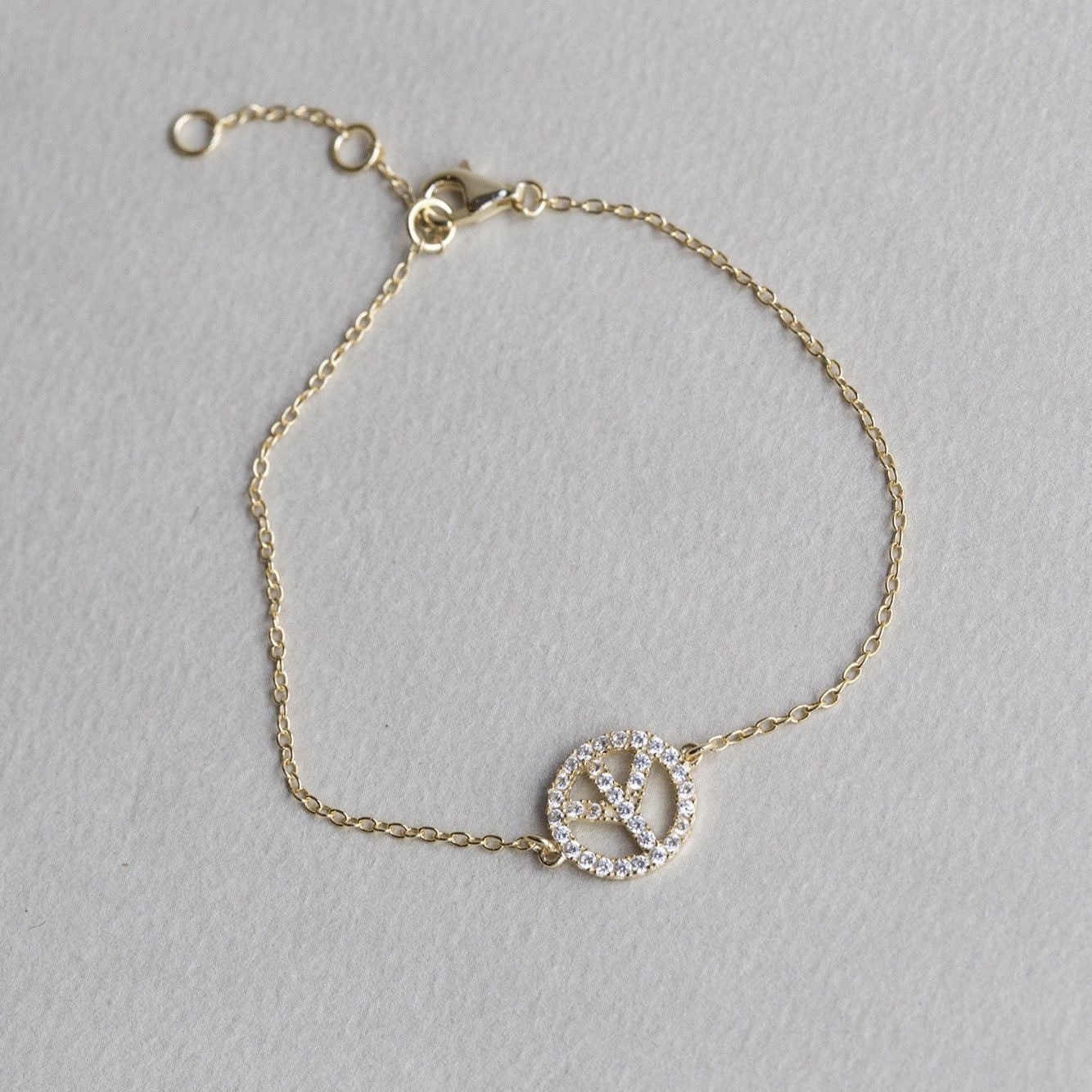 crystal peace symbol bracelet from the same collection is also for sale on feltlondon.com