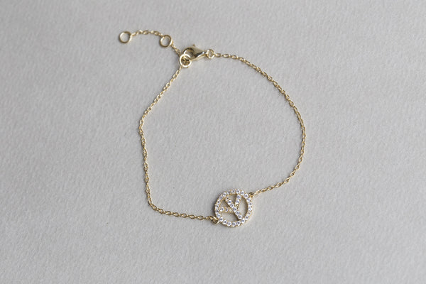 delicate crystal peace sign bracelet that belongs to our delicate bracelet collection