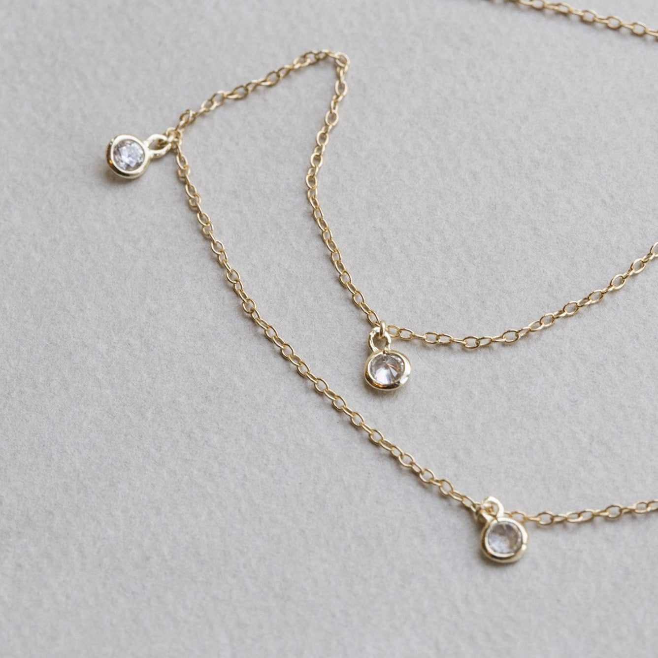 the length and the presence of clasp, allows this necklace to be layered on wrist