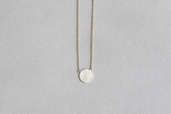 matte finish lustrous disc necklace