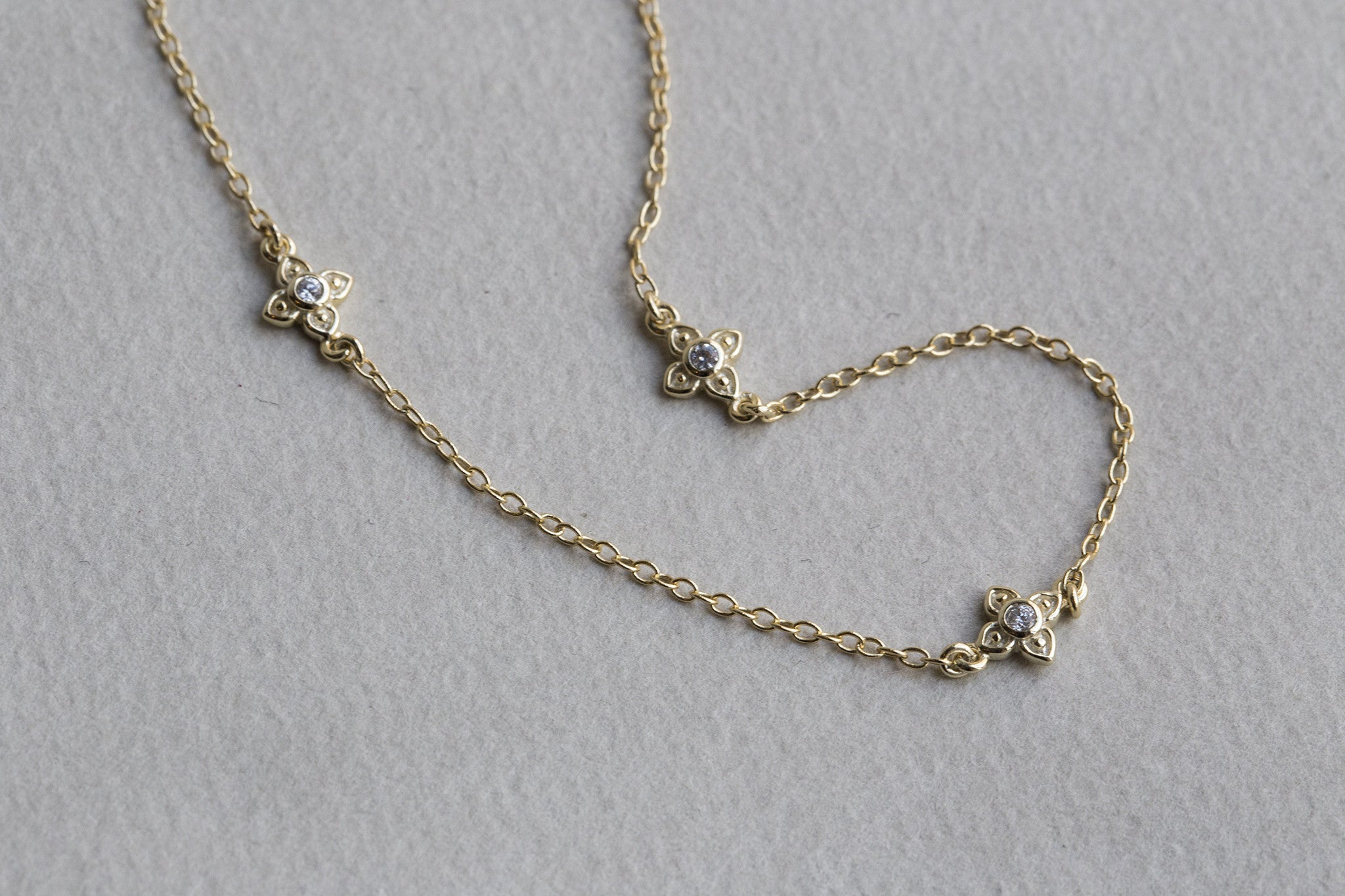 the clover design is based on a vintage jewellery