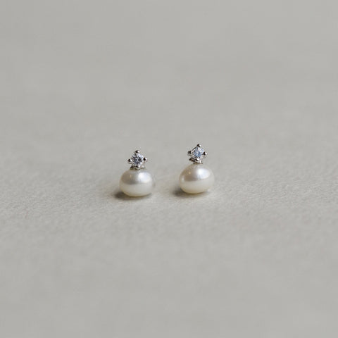 felt freshwater pearl and cubic zirconia crystal set in silver stud earrings