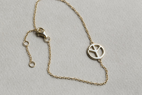 lovely shiny finish on peace sign bracelet
