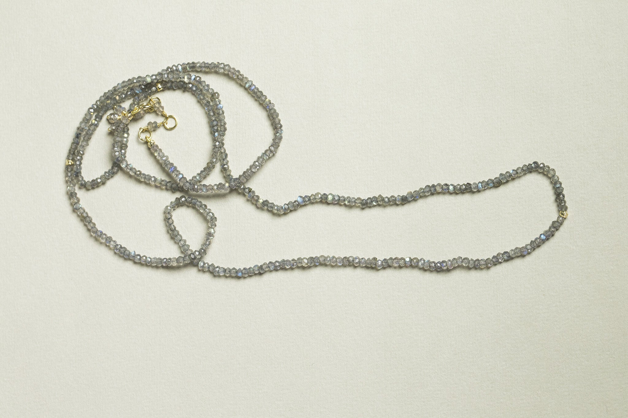 the back of the necklace has a decorative tassel which can be worn in the front