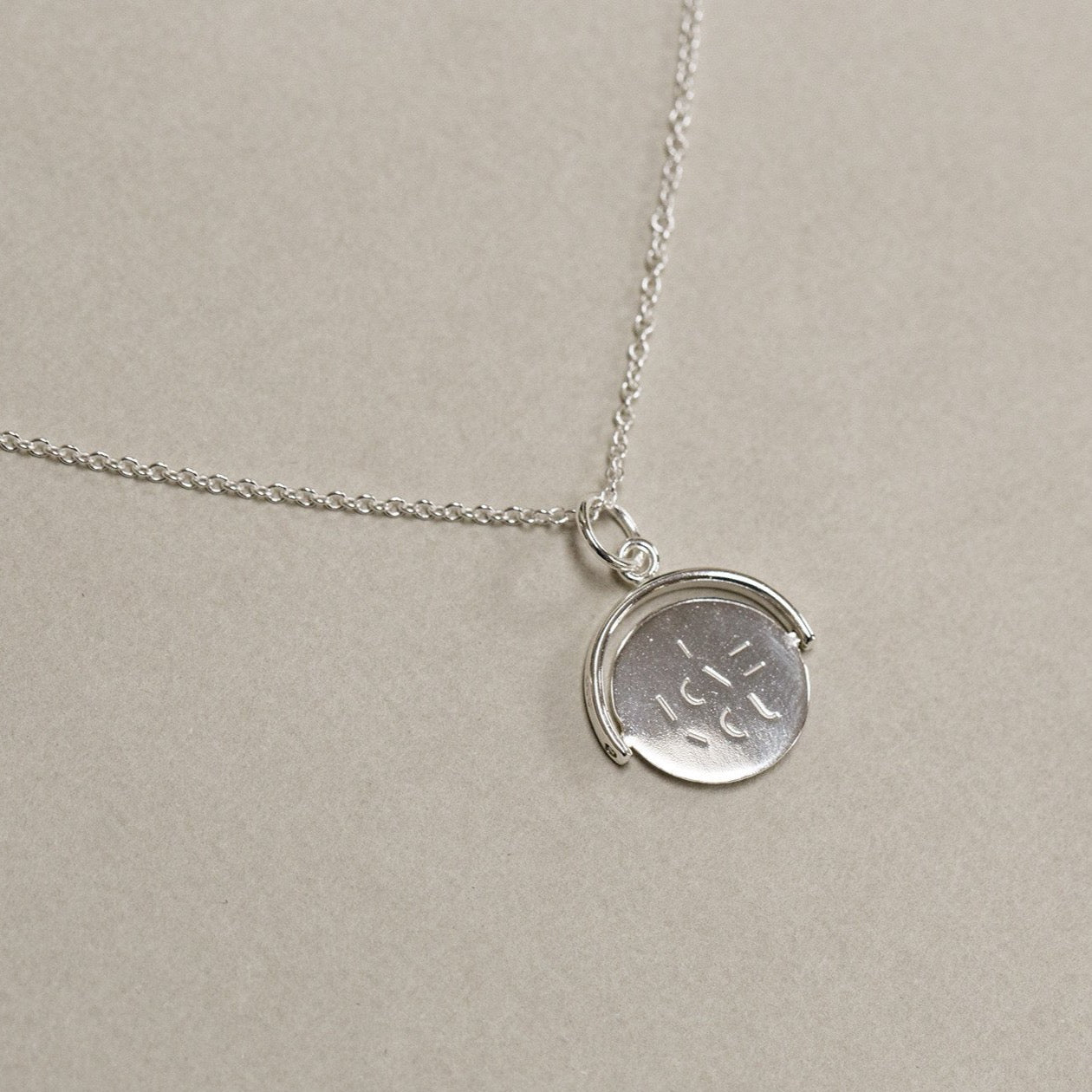 contemporary sterling silver spinning I love you necklace