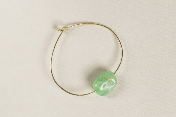 vivid green chrysoprase polished slightly to preserve its inclusion and the organic natural form