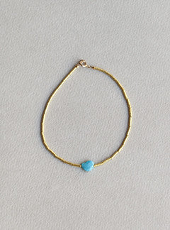 Mary Wiles gold tube matte bead bracelet with polished turquoise cabochon bead