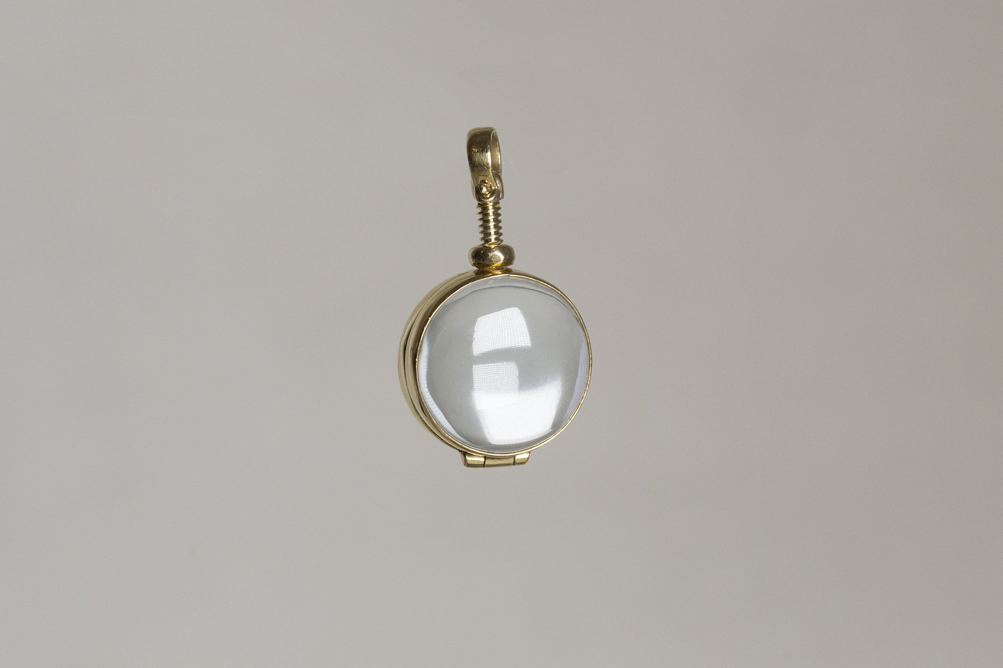 Milina's Round Glass Gold Plated Locket Pendant