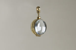 the intriguing mechanism of the glass cabochon locket from up close