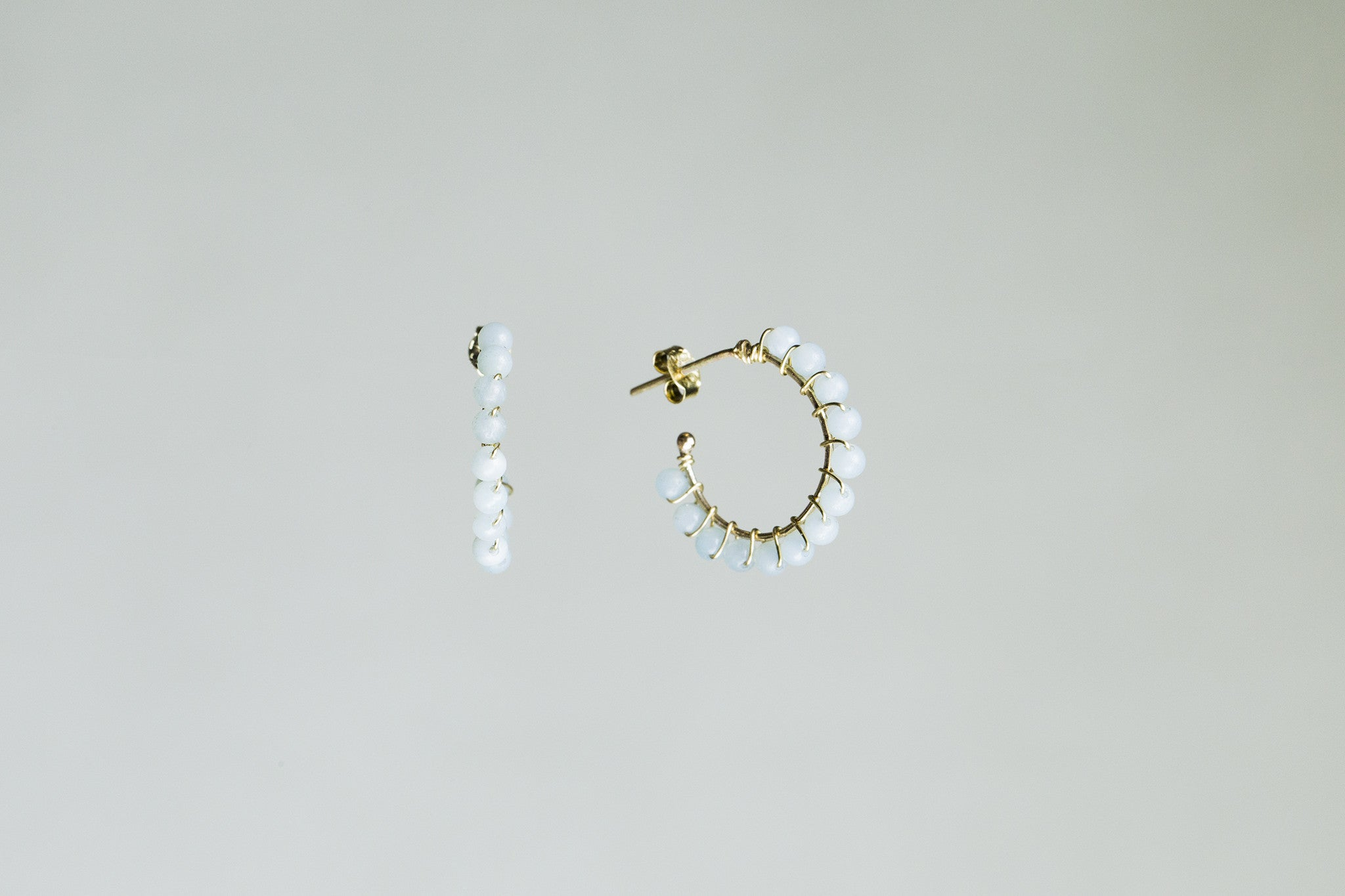 subtle pale blue amazonite wrapped around gold hoop, simple and beautiful jewellery from Molo