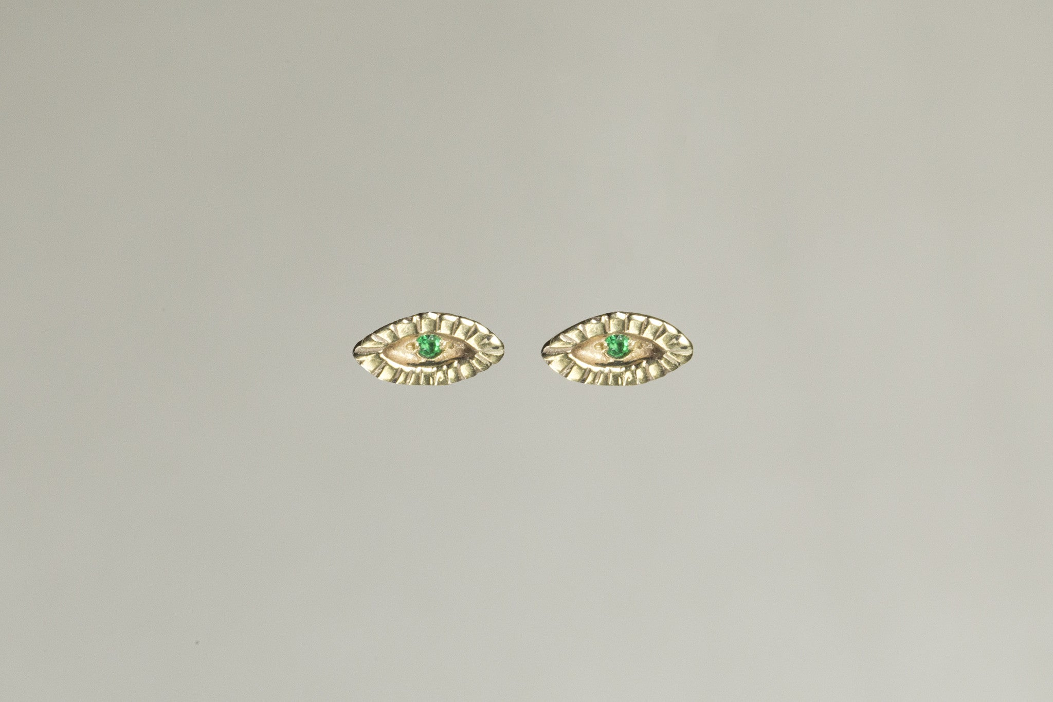 Tiny Eye Gold Stud Earrings with Emerald
