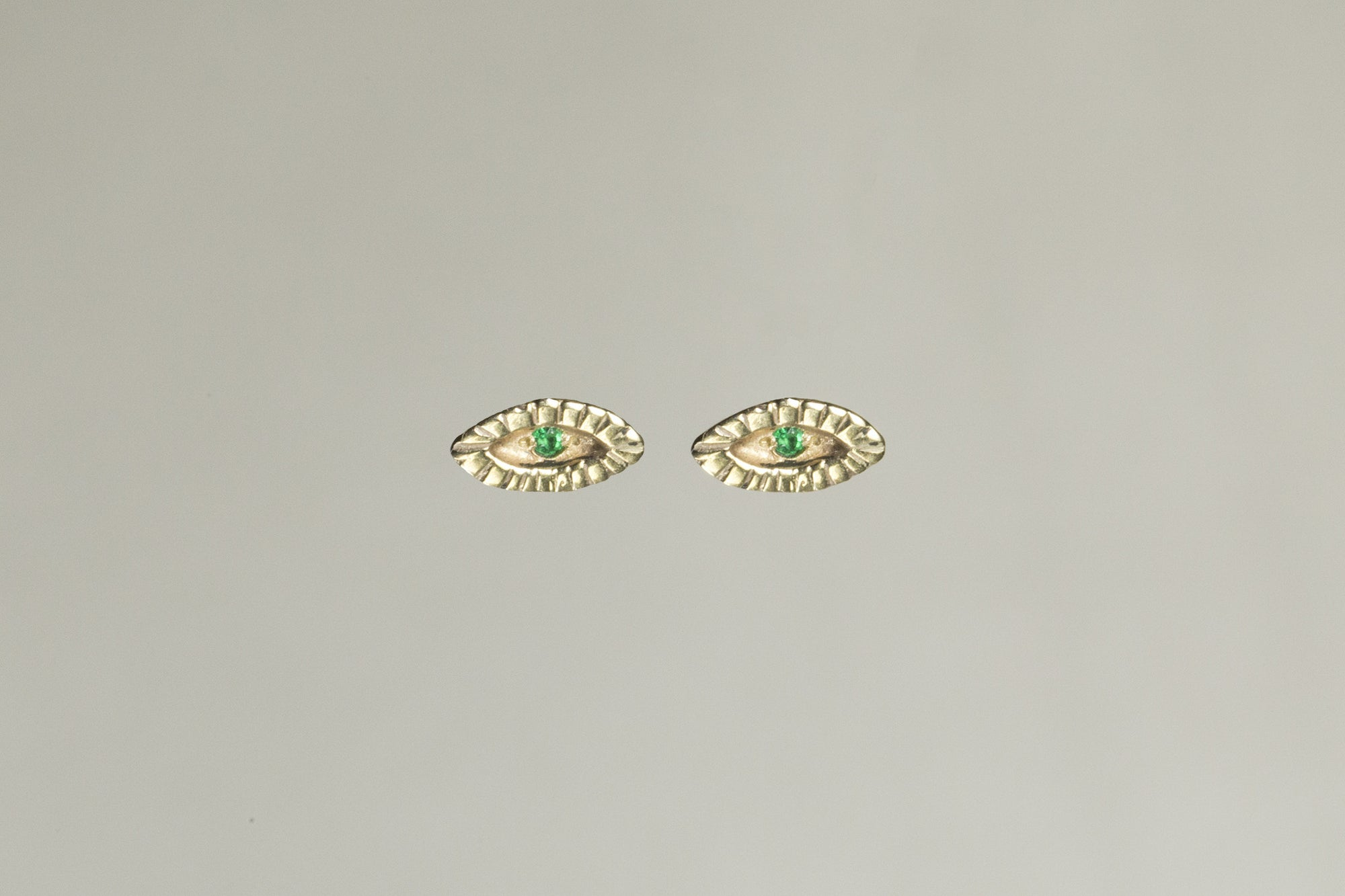 Tiny Eye Gold Stud Earrings with Emerald by Momocreatura