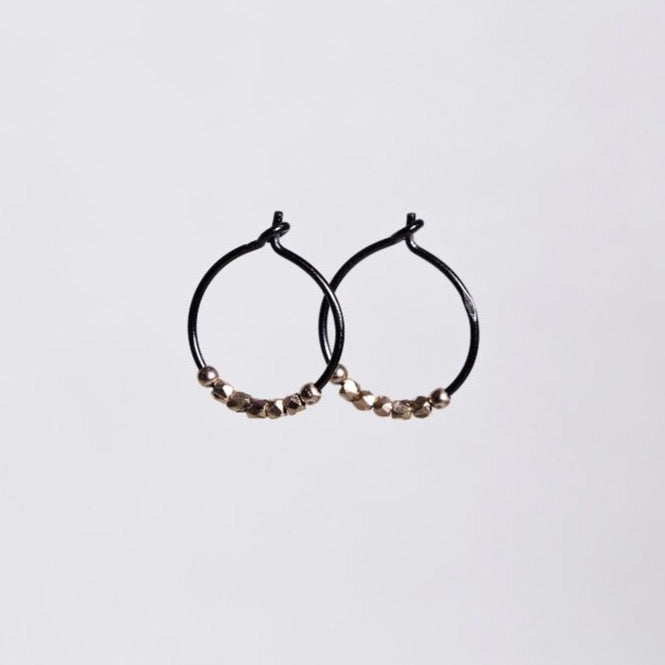 subtle rose gold nugget beads light up the blackened silver hoops