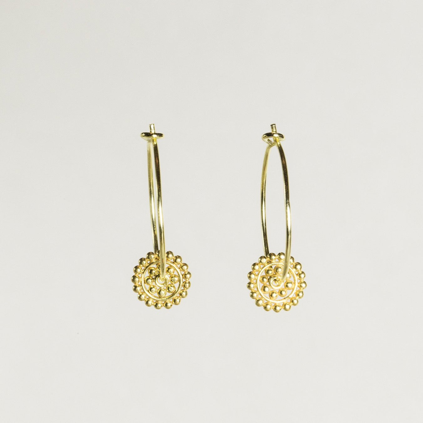 a copy of Roman antique earrings, theses dotted circles are a fantastic addition to a simple hoop