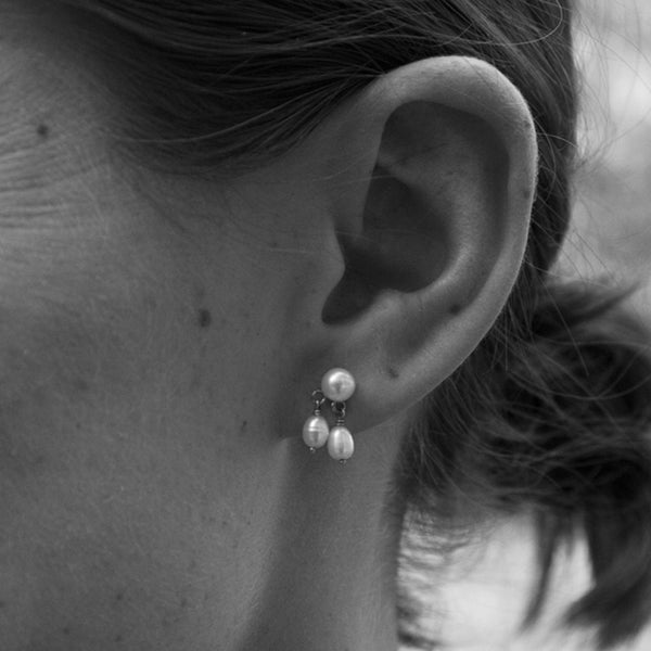 close up shot of the model wearing our pearl drop earrings