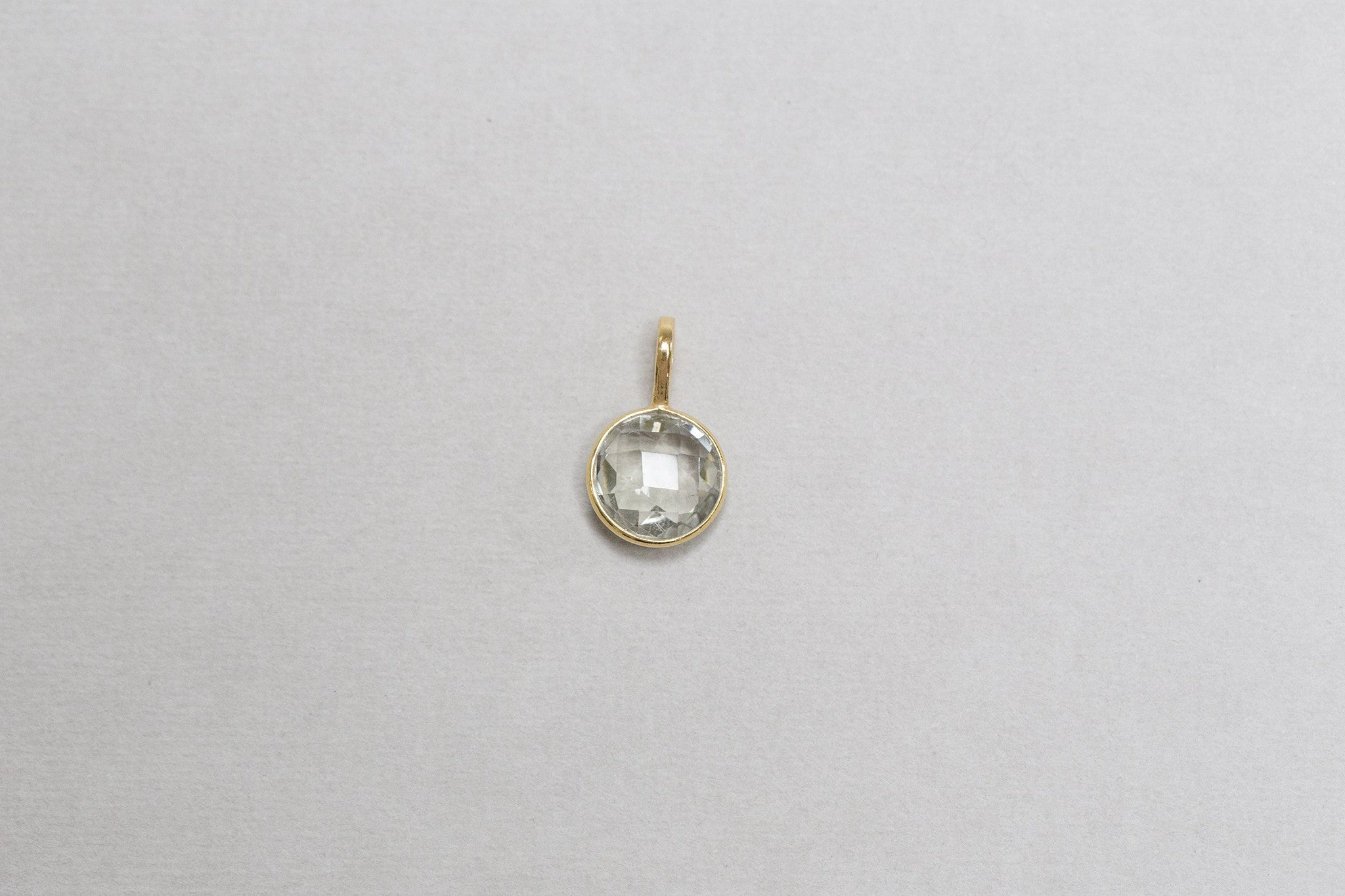 green amethyst charm by Rodgers and Rodgers, set in gold plated silver bezel