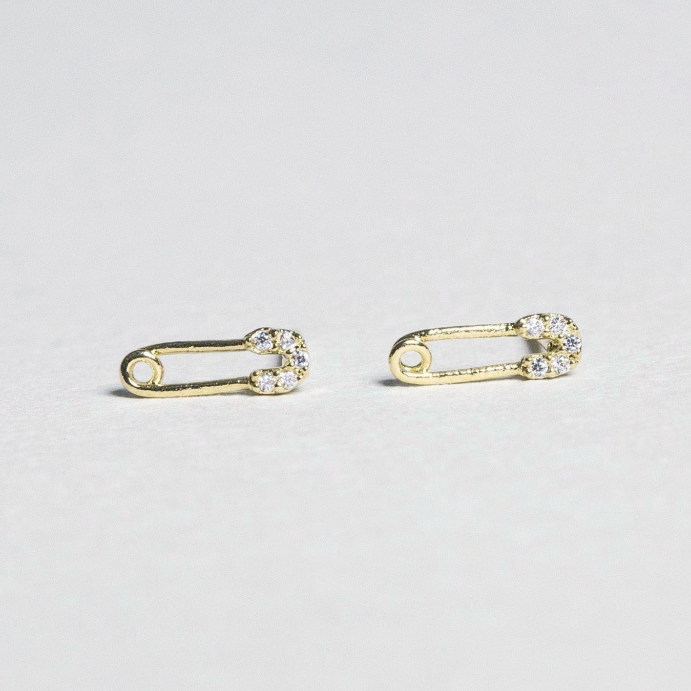 super sweet safety pin earrings witha sprinkle of crystals