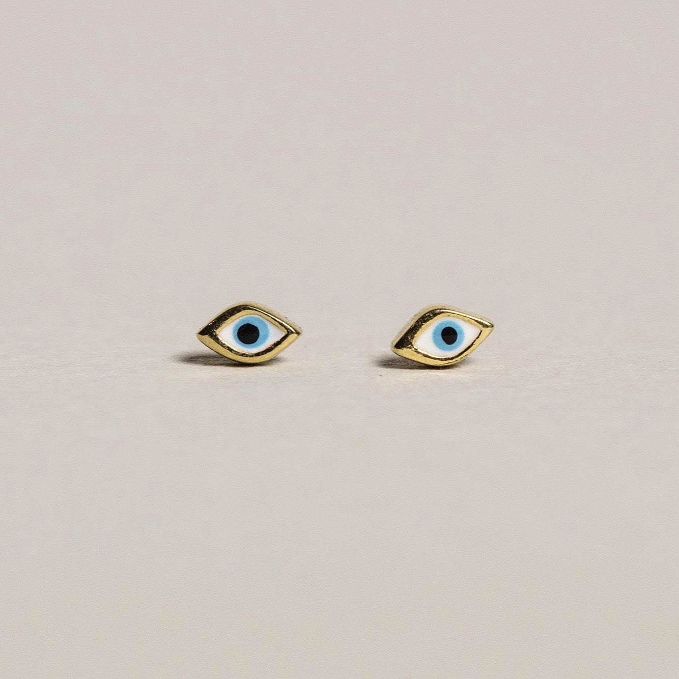 fantastic 'evil eye' micro studs brilliant for multi-pierced!