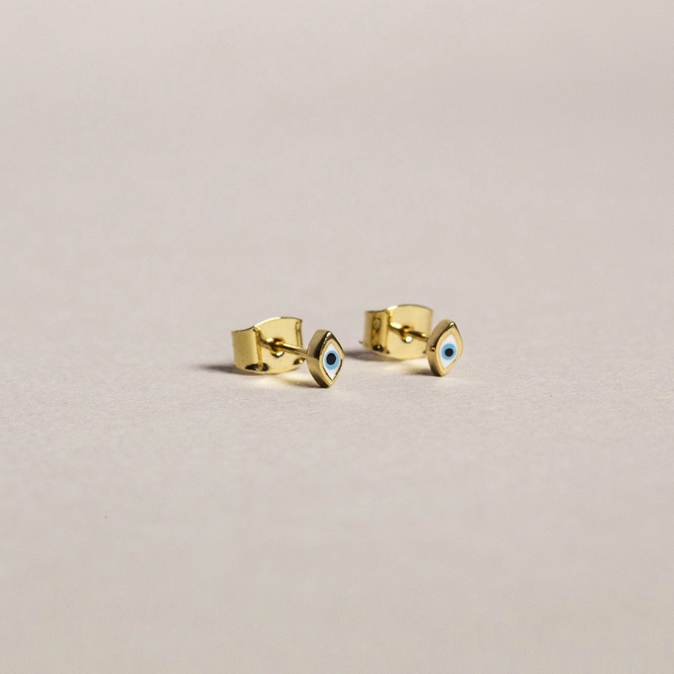 made of gold plated sterling silver, the studs are super cute size (picture with butterflies for comparison)
