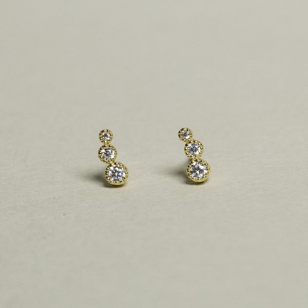 goregeous thre crystal dots in vivid gold plated setting will enchant everyone