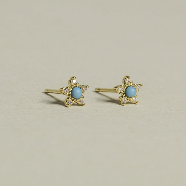 bright turquoise and sparkly crystals in a delicious gold frame - we present you Tai turquoise flower stud earrings