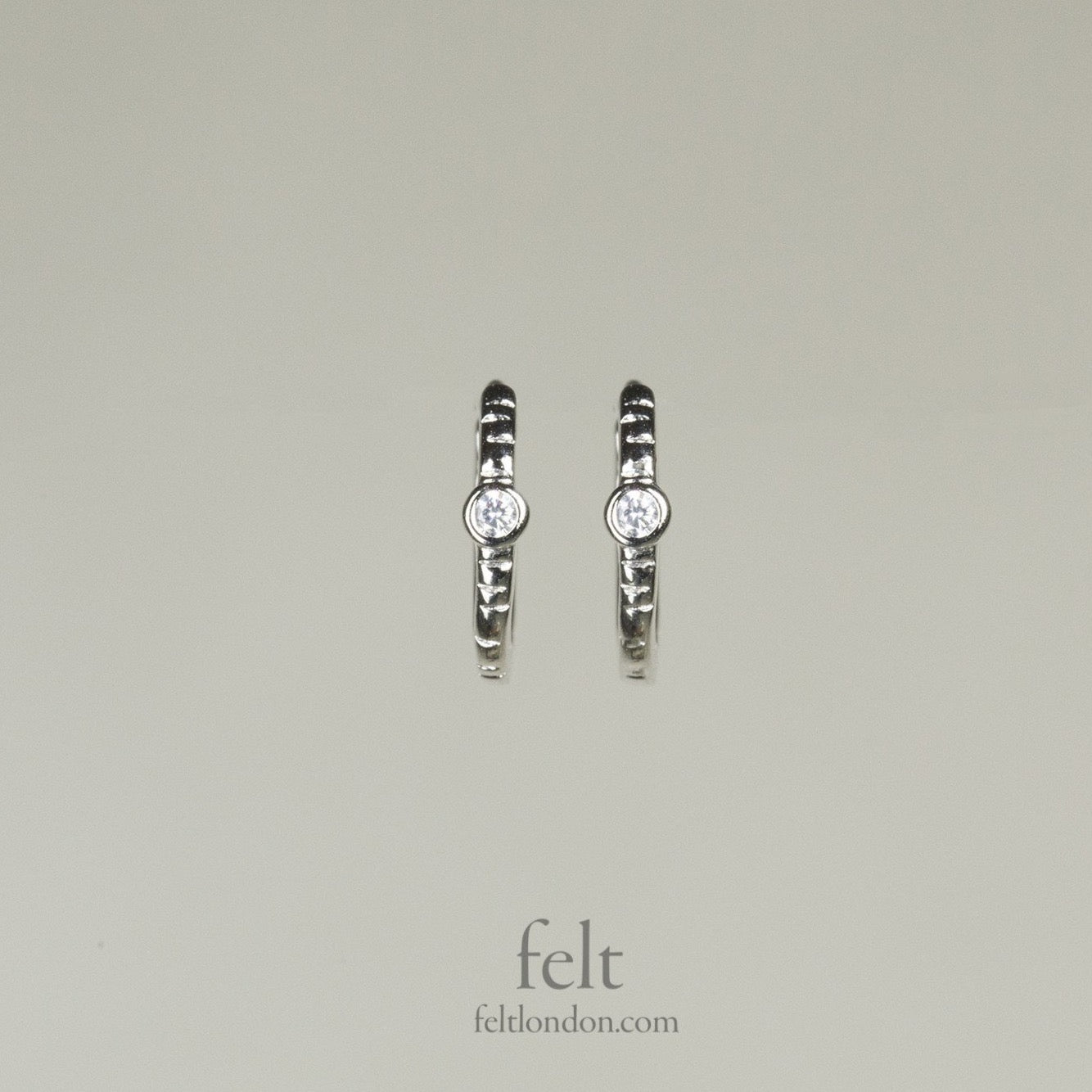 Single stone sleepers in sterling silver with a single cubic zirconia