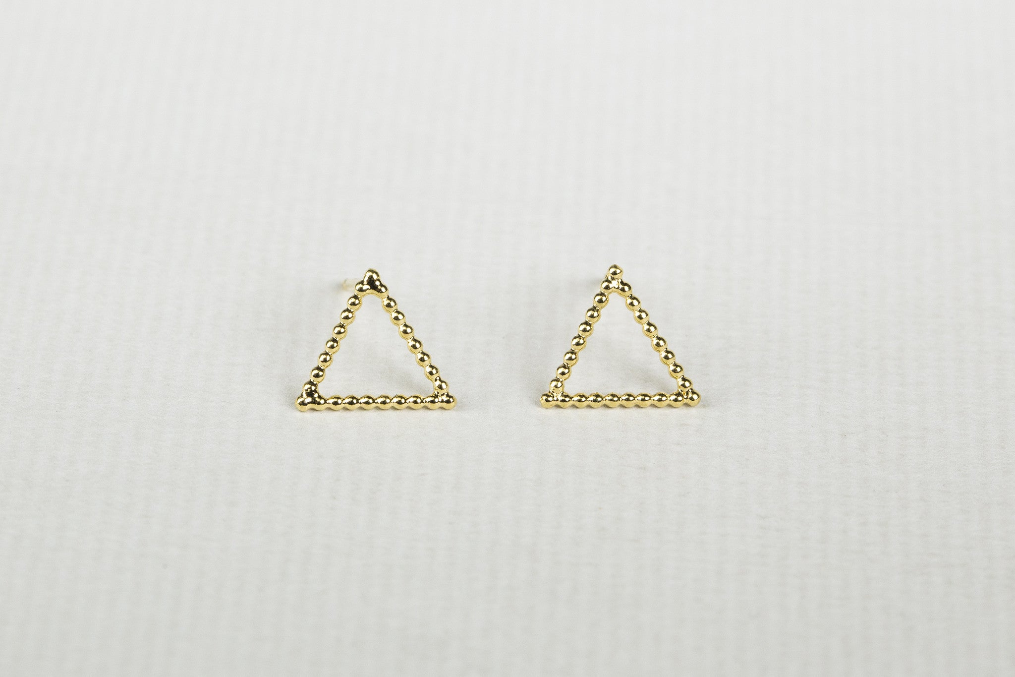 Geometric studs made of gold plated silver