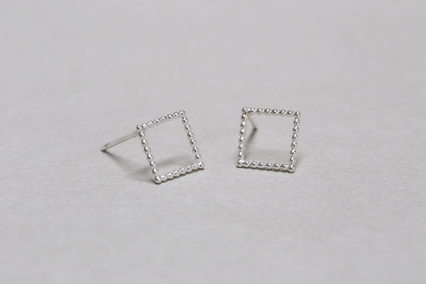 silver 'beaded' squares seen from up close