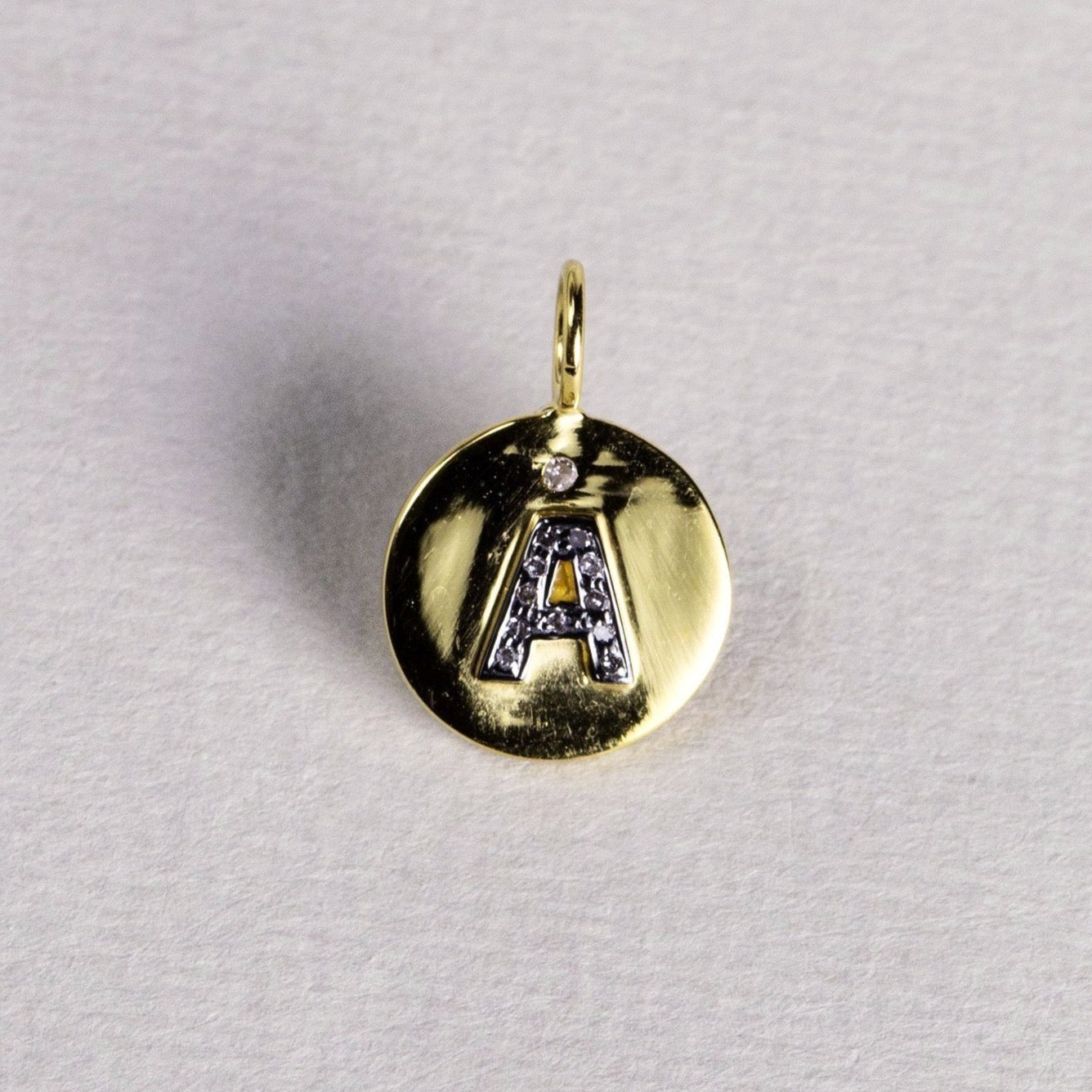 made of 18 carat gold disc with polished finish these initials are as adorable as they can be!
