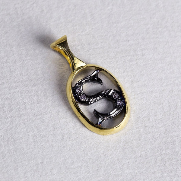 the initial pendants are made of gold, oxidised silver and diamonds