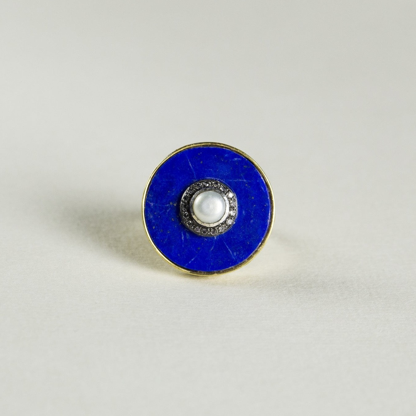 the large lapis disc with a pearl and diamond island