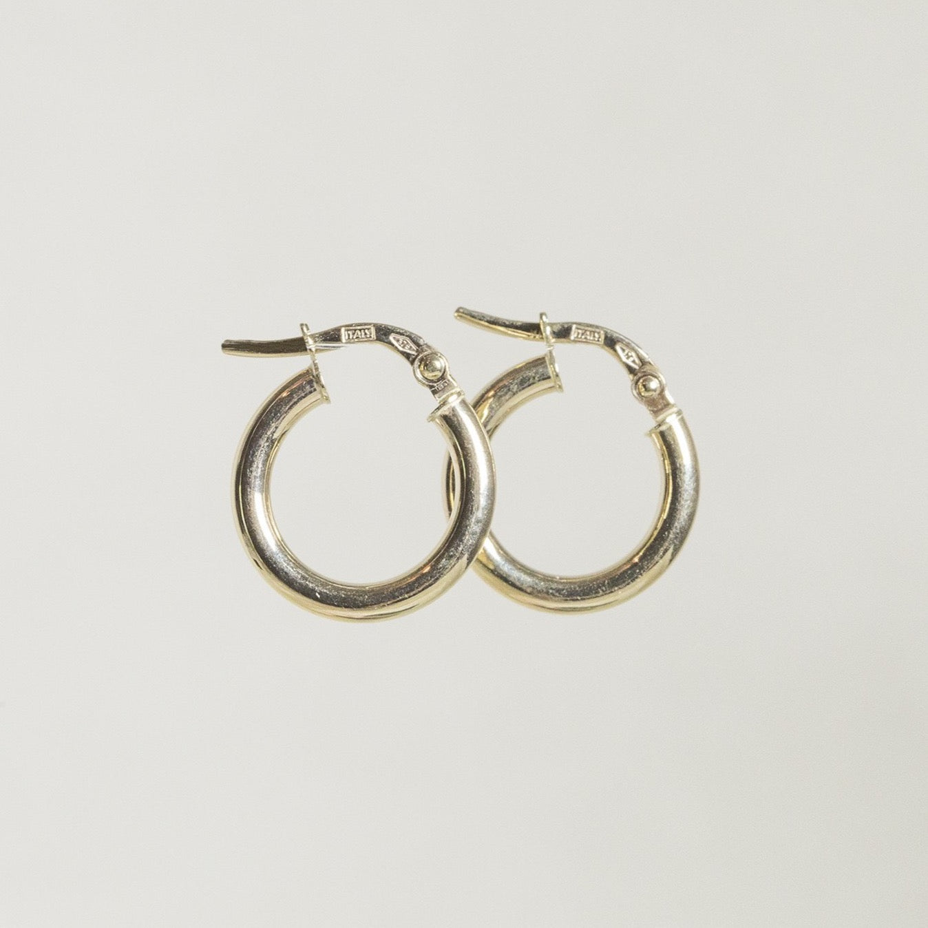 fantastically modern and light gold hoops